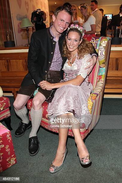 Christine Theiss and husband Hans Theiss attend the Dresscoded Hippie Wiesn 2014 at Golfclub Gut Thailing on August 28 2014 in Steinhoering near...