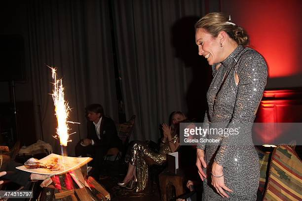 Christine Theiss gets a birthday cake at the Dresswestern party at Rilano No 6 on February 22 2014 in Munich Germany
