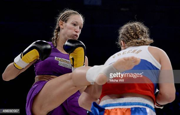 Christine Theiss of Germany exchanges blows with Olga Stavrova of Russia during their WKU World Title fight at Oberfrankenhalle on December 13 2013...
