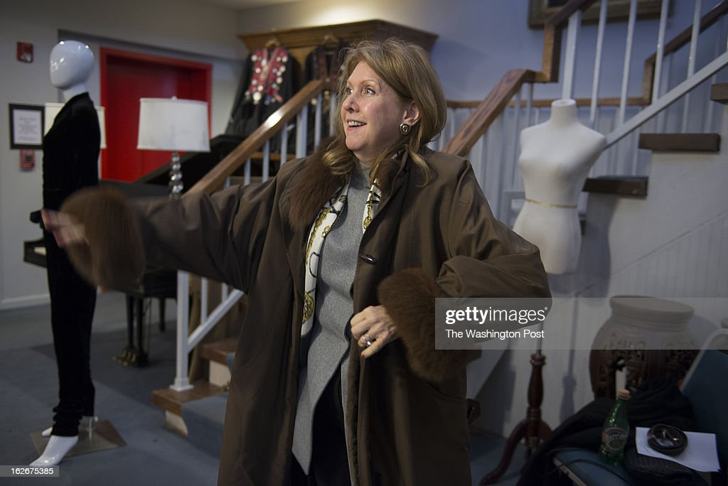 Christine Whitney of Boston, Massachusetts, tries on her prize, a Nina Ricci Fourrures sheared mink-lined impermeable purchased at the Sloans and Kenyon's February Auction of Couture and other Designer Fashion and Jewelry in Chevy Chase, Maryland on February 23, 2013. About 20 percent of the clothing from Sloans & Kenyon auction this Saturday is from the estate of Annelise Fitzgerald, whose husband was ambassador to Ireland from 1992-1993. The couple lived in Georgetown beginning in 1949. Mrs. Fitzgerald's collection includes couture dresses and coats from Christian Dior as well as other custom-made gowns. Two dresses and a set of black silk sheets came from Cissy Patterson one of the first women to run a major daily newspaper, The Washington Times-Herald.