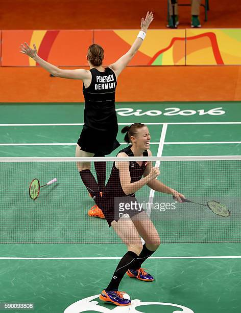 Christinna Pedersen and Kamilla Juhl Rytter of Denmark celebrate their match win over Yuanting Tang and Yang Yu of China during the Women's Doubles...