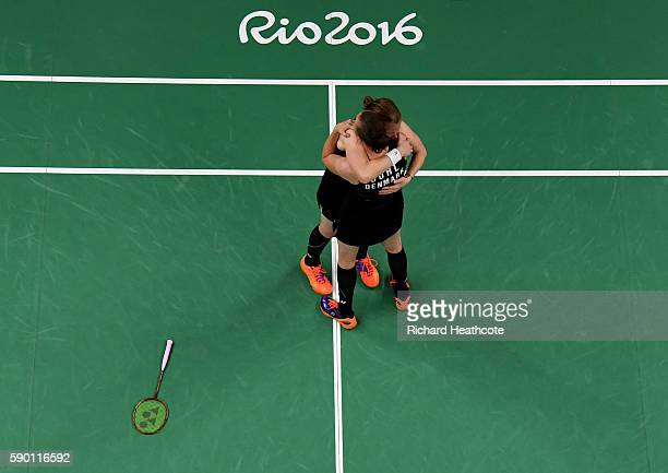 Christinna Pedersen and Kamilla Rytter Juhl of Denamrk celebrate their victory over Tang Yuanting and Yu Yang of China in the Badminton Women's...