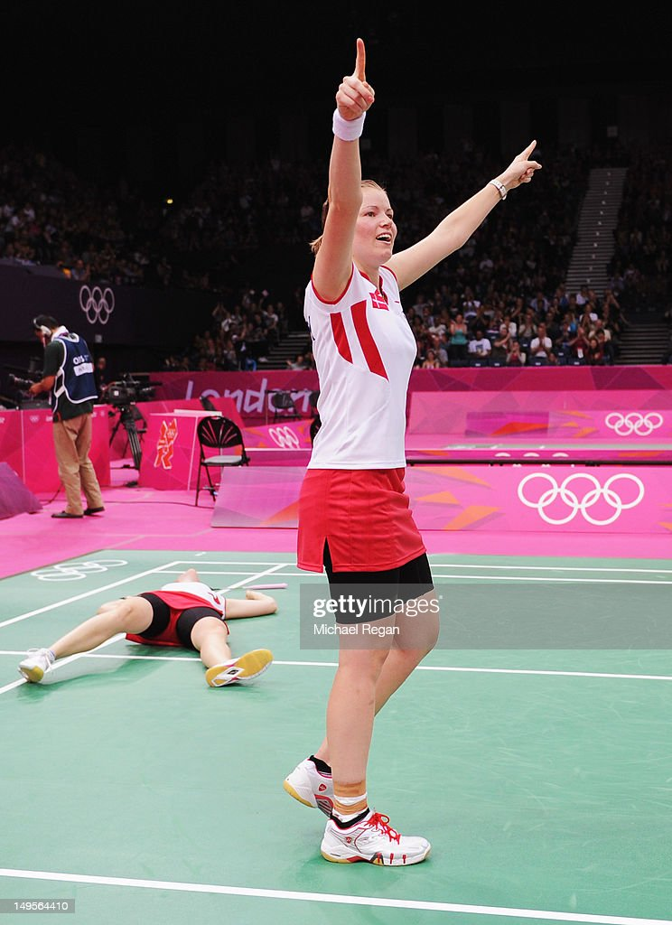 Christinna Pedersen and <a gi-track='captionPersonalityLinkClicked' href=/galleries/search?phrase=Kamilla+Rytter+Juhl&family=editorial&specificpeople=210999 ng-click='$event.stopPropagation()'>Kamilla Rytter Juhl</a> (L) of Denmark celebrate victory in their Women's Doubles Badminton match against Yunlei Zhao and Qing Tian of China on Day 4 of the London 2012 Olympic Games at Wembley Arena on July 31, 2012 in London, England.