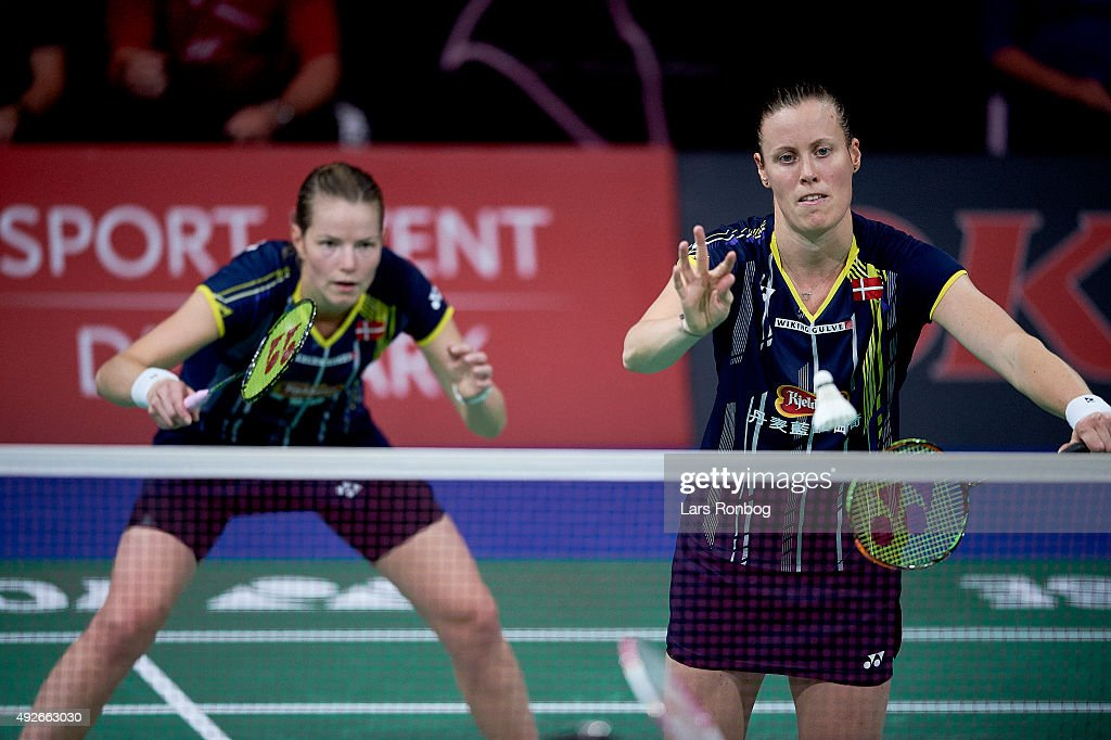 Christinna PEDERSEN and Kamilla RYTTER JUHL of Denmark in action during Day Two at the MetLife BWF World Superseries Premier Yonex Denmark Open Badminton at Odense Idratshal on October 14, 2015 in Odense, Denmark.