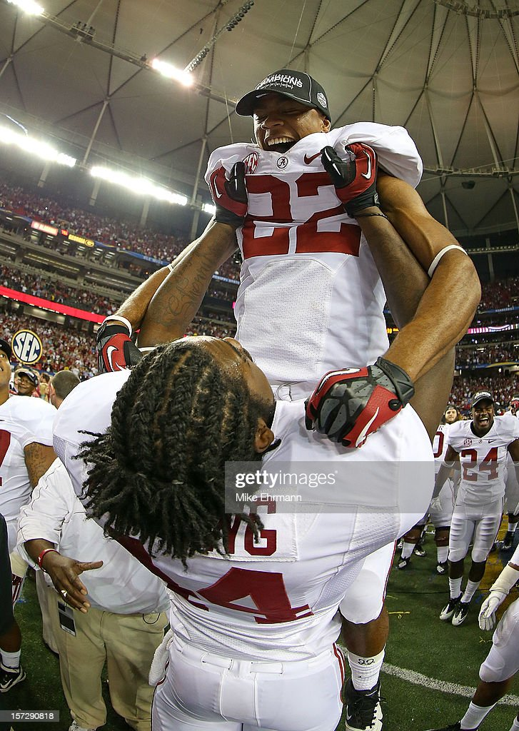 Christion Jones #22 and LaMichael Fanning #44 of the Alabama Crimson Tide celebrate after winning the 2012 SEC Championship against the Georgia Bulldogs at Georgia Dome on December 1, 2012 in Atlanta, Georgia.