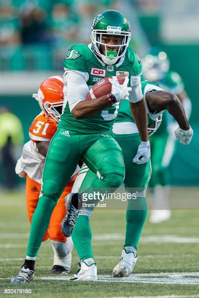 Christion Jones of the Saskatchewan Roughriders carries the ball during the game between the BC Lions and the Saskatchewan Roughriders at Mosaic...