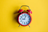 christmas alarm clock on yellow background