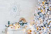 Christmas and New Year Eve Tree. Holiday winter background. Interior details - mirror-snowflake, mantelpiece with garland of light bulbs.