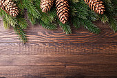 Christmas background. Christmas tree with decoration and pinecone on old wooden background. Xmas card. Top view. Copy space