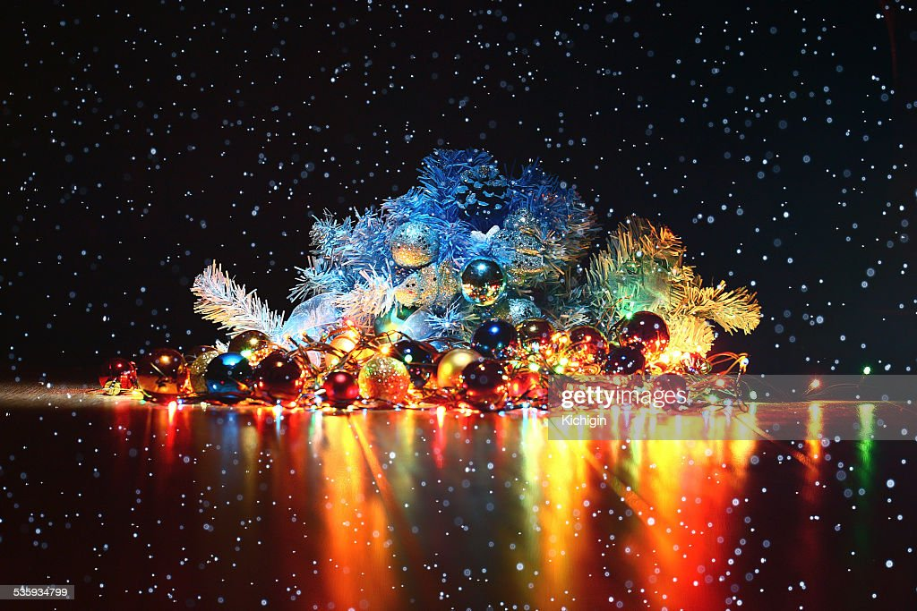 Christmas background, garland lights toys snowflakes snow glare night : Stock Photo