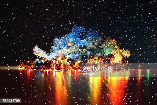 Christmas background, garland lights toys snowflakes snow glare night : Stock Photo