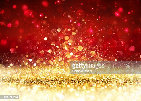 Christmas Background - Golden Glitter On Shiny Red : Stock Photo