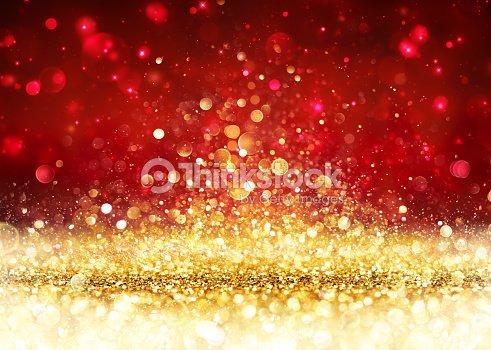 Christmas Background - Golden Glitter On Shiny Red : Stock Photo