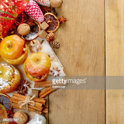 Christmas background of Homemade baked stuffed apples and spices : Stock Photo