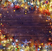 Pine Branches And String Lights On Dark Plank 858008608 IStock Christmas Background