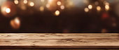 Christmas background with light spots and bokeh in front of a table