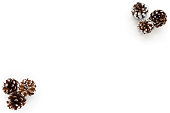White Christmas Background with six hand painted snowy, white pine cones isolated on white background. Three pine cones each in right top corner and left bottom corner.
