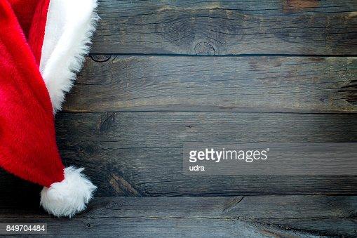 Fondo de Navidad con Santa Claus sombrero vintage juntas : Foto de stock