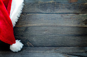 Christmas abstract background with Santa Claus hat on vintage boards