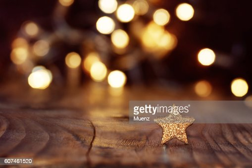 Christmas background with stars and bokeh : Stock Photo