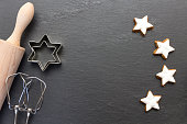 cinnamon star cookies on slate background with bakery utilities