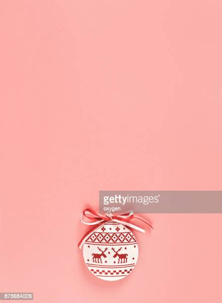 Christmas ball ornament on pink colored background