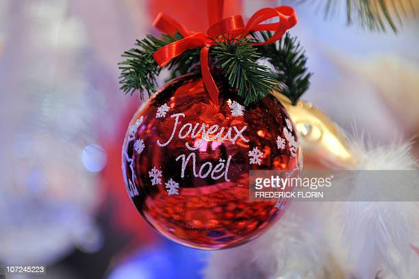 A Christmas ball reading ' Merry Christmas' is seen on November 27 2010 during the opening of the Strasbourg Christmas market which is the largest...