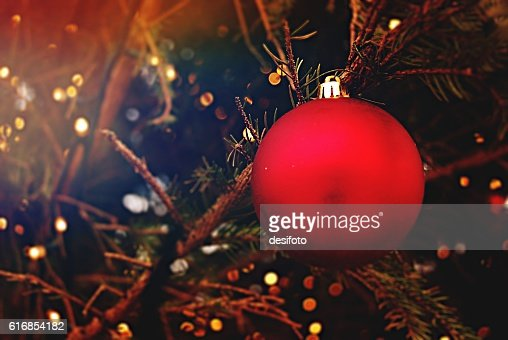 Christmas Bauble hanging on a tree : Stock Photo