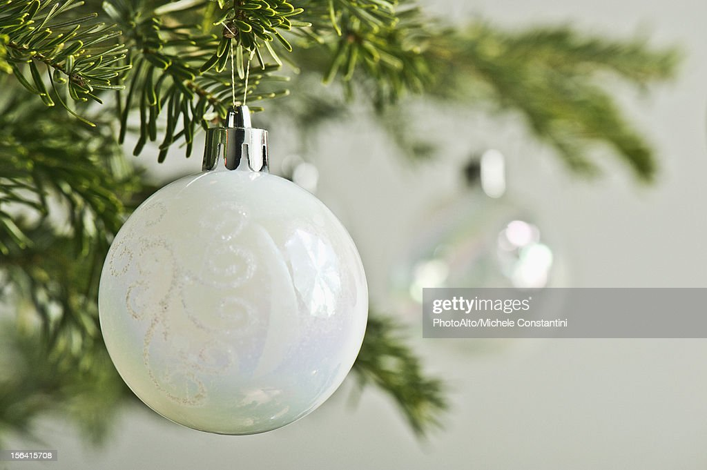 Christmas baubles hanging from Christmas tree, close-up : Stock Photo