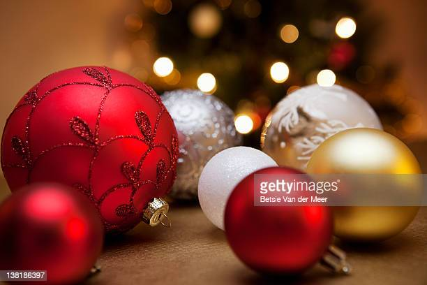 Christmas baubles laying on table.