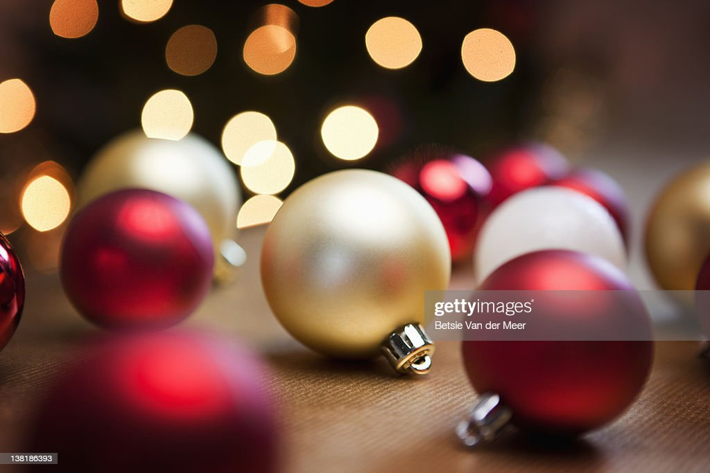 Christmas baubles on table.