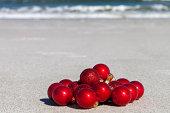 Christmas Baubles On The Beach