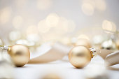 Golden christmas baubles , horizontal