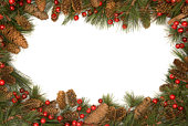 Christmas Border Of Pine Branches Against White Background