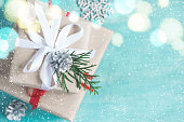 Christmas boxes of gifts festively decorated On a turquoise background, selective focus.