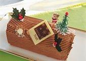Christmas cake rolled up and covered with chocolate cream, Yolu log