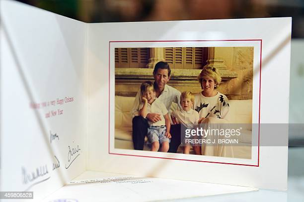 Christmas Card signed by Prince Charles and the late Princess Diana is among items beside dresses on display at Julien's Auction House in Beverly...