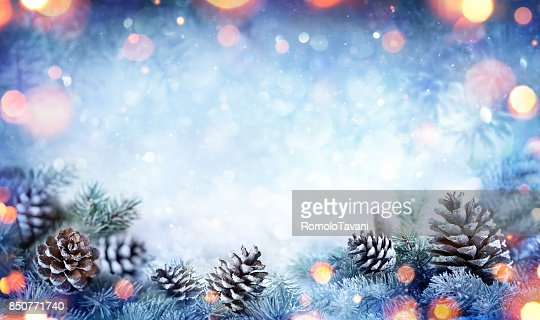 Christmas Card - Snowy Fir Branch With Pine Cones And Lights : Stock Photo