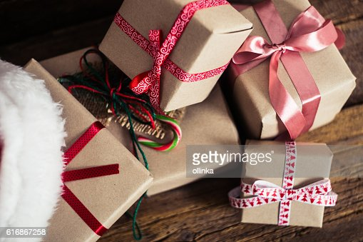 Christmas cards and gifts with Santa hats on wooden background : Stock Photo