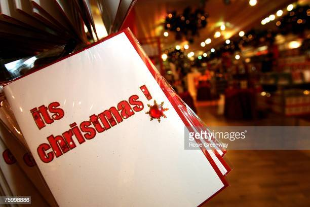 Christmas cards are displayed with Christmas themed merchandise at Harrods in Knightsbridge for the launch of the store's 'Christmas World' on August...