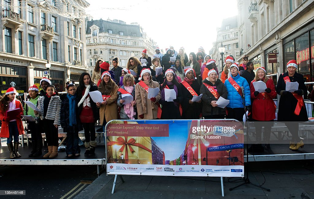 A Christmas carolling choir performs as hoppers walk down Oxford Street during American Express Shop West End VIP Weekend on DECEMBER 10, 2011 in London, England. West End stores predict £180m sales today with 1m shoppers spending on fashions and gifts. Over 50,000 'early bird' shoppers were out in London's West End by 8.30am this morning for a bumper Christmas shopping day, as the West End removed all traffic on Oxford Street and Regent Street to make way for festive shoppers for the 7th American Express Annual Shop West End VIP (Very Important Pedestrian) Weekend.