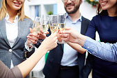 Group of colleagues toasting with champagne