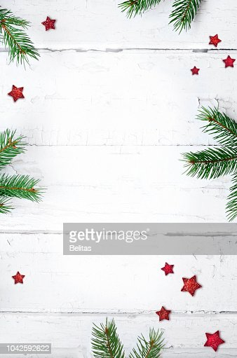 Christmas composition. Christmas gift, candy cane and fir tree branches. Top view, flat lay. : Stock Photo