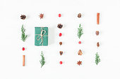 Christmas composition of pine cones, cypress branches, cranberry, christmas gift, cinnamon sticks. Top view, flat lay