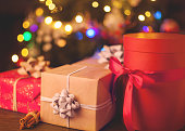 New Year's gifts in focus under the Christmas tree