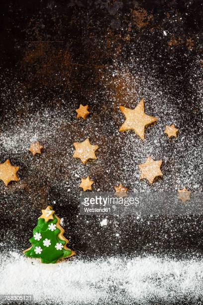 Christmas Cookies and icing sugar on baking tray