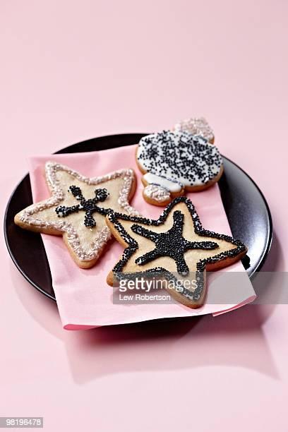 Christmas cookies on pink napkin and black plate
