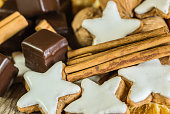Christmas biscuits, chocolate pieces, nuts and cinnamon decoration