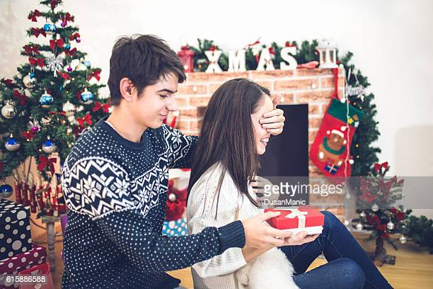 Christmas Couple. Happy Smiling Family at home celebrating.