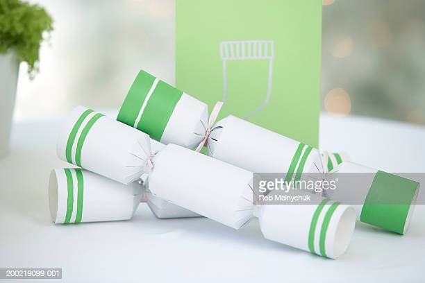 Christmas crackers beside greeting card